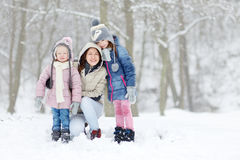 Young mother and her two daughters on winter Royalty Free Stock Photography