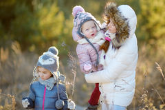 Young mother and her two daughters on winter Royalty Free Stock Images