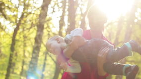 Young mother and her two years old baby boy playing in park stock footage