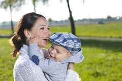 Young mother with her young child  close up Stock Images