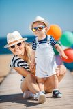 Young mother and her young son on the beach. Stock Photos
