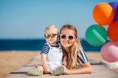Young mother and her young son on the beach Stock Image