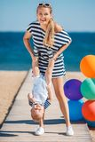 Young mother and her young son on the beach Royalty Free Stock Photos