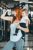 Young mother with her young son in the gym Stock Images
