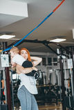 Young mother with her young son in the gym Royalty Free Stock Photos