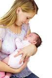 Young mother holding baby Stock Images