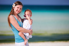 Young mother holding baby daughter Stock Photos
