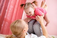 Young mother holding baby, fun, exercise, leisure. Young mother with baby have fun doing exercise, leisure - concept royalty free stock photography