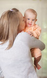 Young mother holding a baby Stock Image