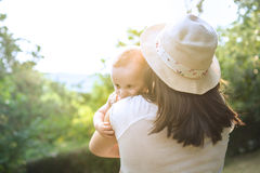 Young mother holding a baby in nature Stock Image