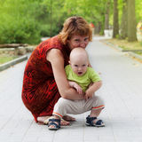 Young mother holding a child Stock Photos