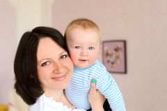 Young mother holding cute baby son royalty free stock photography