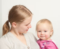 Young mother holding daughter Stock Images