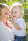 Young Mother Holding Her Adorable Baby Boy Stock Photography
