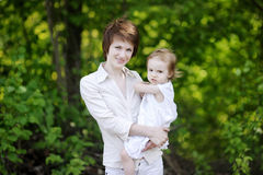 Young mother holding her adorable girl Royalty Free Stock Image