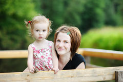Young mother holding her adorable girl Stock Photography