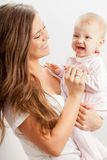 Young mother  holding her baby girl on hands Stock Photos
