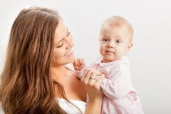 Young mother  holding her baby girl on hands Royalty Free Stock Images