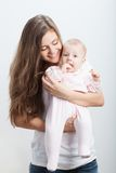 Young mother  holding her baby girl on hands Stock Photography