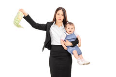 Young mother holding her baby and stinky diaper Royalty Free Stock Photos