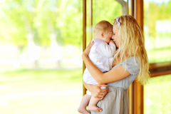 Young mother holding her little baby outdoors Royalty Free Stock Image