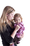 Young mother holding her little girl in her arms Royalty Free Stock Images