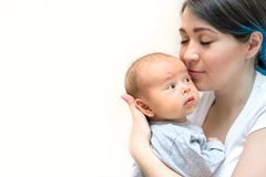 Young mother holding her newborn child. Mom nursing baby royalty free stock photo