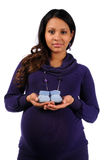 Young Mother Holding Knitted Baby Shoes Stock Image