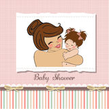 Young mother holding a new baby girl. Pretty young mother holding a new baby girl Stock Photography