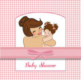 Young mother holding a new baby girl. Pretty young mother holding a new baby girl Stock Photos
