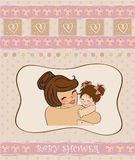 Young mother holding a new baby girl. Pretty young mother holding a new baby girl Royalty Free Stock Image