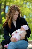 Young mother holding newborn baby. Young mother holding her sleeping newborn baby Royalty Free Stock Photography
