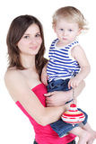 Young mother holds in arms her little son. Who holds pegtop Royalty Free Stock Photography