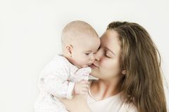 Mother holds baby in her arms on isolated background stock images