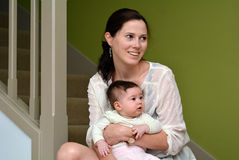 Young mother holds her baby at home Stock Image