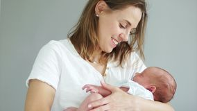 A Young Mother Holds Her Sleeping Newborn Baby In Her Arms Surrogacy Ivf