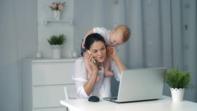 Working mother with baby stock video footage
