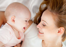Young mother hugging baby Stock Photo