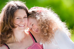 Young mother hugging her daughter Royalty Free Stock Image