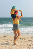 Young mother hugging her daughter on beach Royalty Free Stock Photo