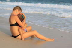 Young mother hugging her daughter at the sea Royalty Free Stock Images