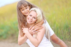 Young mother hugging her daughter Royalty Free Stock Photo