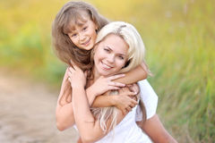 Young mother hugging her daughter Royalty Free Stock Photos