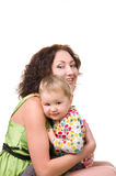 Young mother hugging her little baby Stock Photos