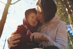 Young mother hugging her little son Royalty Free Stock Photo