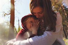 Young mother hugging her little son Stock Photos
