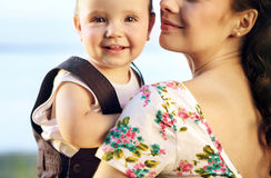 Young mother hugging her todler Royalty Free Stock Image