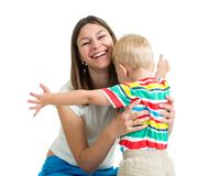 Young mother hugging kid. Son isolated on white Royalty Free Stock Photo
