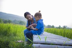 Young mother hugging and soothing a crying little long hair  boy, Asian mother trying to comfort and calm down her crying child. Young mother hugging and stock images