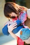 Young mother hugging tenderly her sleeping son Royalty Free Stock Photography